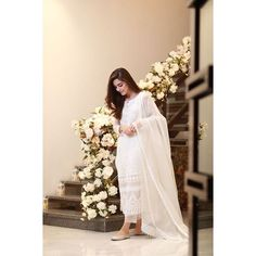 Maya Ali stuns in this long wide bottomed well-adorned tangerine pishwas. The net bodice and sleeves are embellished with embroidery and… Pakistani Party Wear Dresses, Pakistani Wedding Outfits, Eid Dresses, Pakistani Dress Design, Indian Dresses, Indian Outfits, Women's Fashion Dresses, White Anarkali, Anarkali Suits