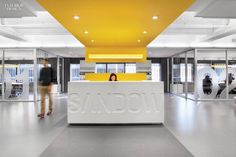The Sandow logo was CNC-cut into the solid-surfacing of thereception desk at the New York headquarters by Gensler. Photography by Paul Godwin.