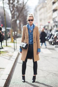 Go for a classic style in a camel coat and black leather slim pants. A pair of black leather booties will seamlessly integrate within a variety of outfits. Shop this look for $128: http://lookastic.com/women/looks/scarf-and-longsleeve-shirt-and-coat-and-crossbody-bag-and-skinny-pants-and-ankle-boots/3861 — Light Blue Scarf — Blue Long Sleeve T-shirt — Camel Coat — Black Leather Crossbody Bag — Black Leather Skinny Pants — Black Leather Ankle Boots