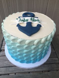 Triple layer baby boy baby shower cake with blue ombré buttercream and nautical theme fondant decorations