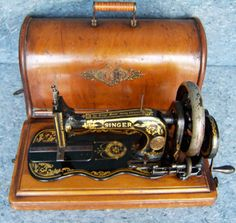 Treadle and Hand Crank Machines Vintage sewing machine with case .