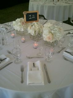 Something like this from her events would be good because they're small, but 3 of them makes more of an impact. Like the idea of maybe having a navy table runner and pink flowers in here.