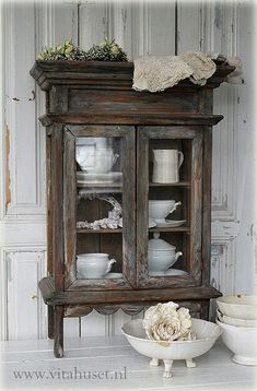 Wow, I just love this mini cabinet with all of its rustic charm.