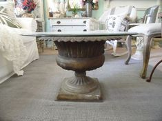 I took an antique cast iron garden urn and turned it into a beautiful coffee table.  A taller urn would make a great kitchen table also