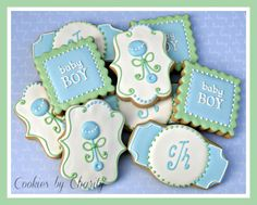 Decorated cookies for a baby boy shower - expecting, blue, monogram, rattle.  www.facebook.com/cookiesbycharity