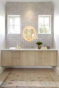 Warm, stylish and glowing beige bathroom boasting a beige wood floating washstand with a white marble vanity countertop under a wall finished with gray grid wall tiles. Vanity Countertop, Tile Countertops, Beige Bathroom, Master Bathroom, Feminine Bathroom, Bathroom Marble, Master Shower, Light Bathroom, Downstairs Bathroom
