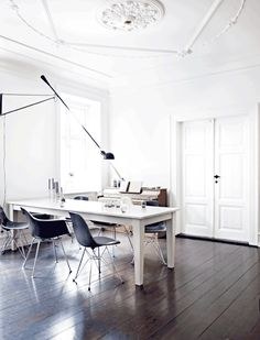FLOS 265 wall lamp adds grace and elegance to this minimalist study with dark wood floors and a white table. Office Interior Design, Office Interiors, Interior Livingroom, Design Scandinavian, Scandinavian Kitchen, Danish Interior, Style Loft, Apartment Design, White Walls