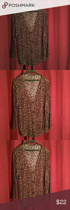 french laundry animal print top  This is attractive button top v neck animal print great fitting light 100percent rayon  attractive looking on like new worn maybe once all items without tags or even if tag fell off are dry cleaned or laundry before their leave  French laundry Tops