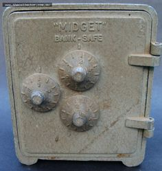 Lot 335 - Die cast metal 'Midget Bank safe with combination lock