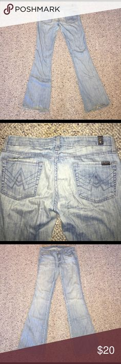 Seven For All Mankind light wash A pocket These jeans are worn. Scale 1-10: 4. There's a hole in the knee I created but still wore the jeans even after it happened. This was one of my favorite pair of sevens and they still have some good wear left in them! 7 For All Mankind Jeans Flare & Wide Leg