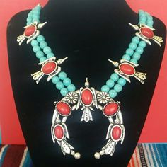 TURQUOISE & Red Howlite Squash Blossom Necklace Beautiful Large Silvertone Metal genuine Turquoise & dyed Red Howlite featuring Dodo birds. While this is NOT the high price Squash Blossom necklaces you see that are made by the Native Americans, it is certainly not a piece to be overlooked. Yes this is HIGHER end costume jewelry and you won't be disappointed! You can own a Squash Blossom necklace without paying the hundreds of dollars to get it. **Matching Earrings Included.** Questions are…