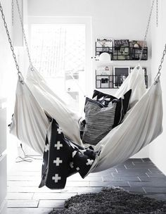 A hammock is the perfect place to recline and relax. Install an indoor hammock for beachy relaxation all year long. For more indoor hammock design ideas, visit domino. My New Room, My Room, Spare Room, My Ideal Home, Bedroom Sofa, Bedroom Hammock, Living Room Hammock, White Bedroom, Cozy Teen Bedroom