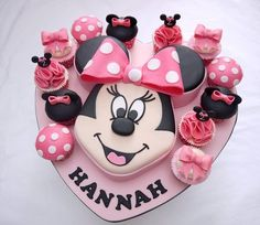 The customer sent me photo of the Minnie face cake and asked me to copy it – i know its been done, done and done again – but i think it came out really well! The cupcakes are a pink version of the red set i did a few months back. The main cake is. Minnie Cake, Mickey Cakes, Mickey Mouse Cake, Minnie Mouse Cake Design, Big Cakes, Cute Cakes, Friends Cake, Character Cakes, Cakes And More