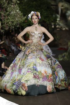 Dolce & Gabbana Fall/Winter 2015-2016 Fashion Show--Like something out of a museum.  A Byzantine-jeweled bodice with a silk skirt decorated with lovely paintings.