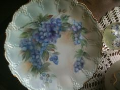 Hand painted porcelain plate by  A. Sullivan{ 1916-2012}