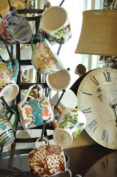 Love Jennifer Rizzo's blog and today she shows an idea I just have to copy.  Organizing my many daily teacups/mugs on a French bottle rack - now to find the rack!