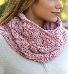 "Knitting Pattern for Dusty Bloom Cowl - This infinity scarf features a leaf motif lace and contrasting garter stitch. Designed by Lena Skvagerson. Finished size is 60"" in circumference x 9""W."