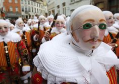 """Gilles of Binche"" dance during a carnival parade in the city center of Binche, Belgium, Tuesday, Feb. 21, 2012. The Carnival of Binche dates back to around the 14th Century, with the clown-like Gilles performing their traditional dances to the sound of drums to ward off evil spirits with their sticks."