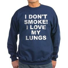 Men's dark color navy blue sweatshirt with I Don't Smoke I Love My Lungs theme. Your lungs are your internal filtration systems for your body. What happens when filters get clogged up? Quit and detox. Available in black, navy blue; small, medium, large, x-large, 2x-large for only $34.99. Go to the link to purchase the product and to see other options – http://www.cafepress.com/stsmoke