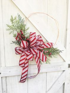 🌲 This Modern Christmas Wreath is bursting with frosted cedar greenery. The finishing touch is the large candy cane ribbon bow that adds so much color to the simple holiday wreath. Add a custom decorator look to your home with this modern Christmas Hoop Wreath for Front Door. Outdoor Christmas Wreaths, Outside Christmas Decorations, Christmas Wreaths For Front Door, Holiday Wreaths, Outdoor Decorations, Christmas Tree, Bumble Bee Decorations, Green Wreath, Modern Christmas