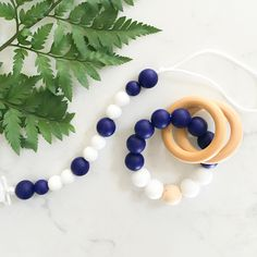 Perfect for any teething baby boy. This Midnight Teething Collection by littleBug includes a Soother Clip and Rattle. These products are made with 100% BPA free, food grade silicone and all natural wood. Each wood piece is coated in olive oil for the safety of your little teether. www.littlebug.ca