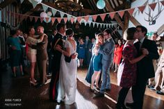 Dance floor at a wedding at Blackstock Barn in Sussex by Anna Pumer Photography www.annapumerphotography.com