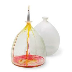 Hand blow vases that catch the wax inside. It can, of course be melted out for re-use. From designer Andi Kovel.