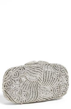 This sparkly crystal swirl clutch is fit for a princess.