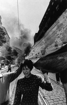 "Josef Koudelka:""Invasion of Warsaw Pact Troops, Czechoslovakian National Flag"" Prague, Czechoslovakia 1968 Henri Cartier Bresson, Magnum Photos, Iconic Photos, Old Photos, Prague Spring, Dark Landscape, Photographer Portfolio, French Photographers, Women In History"