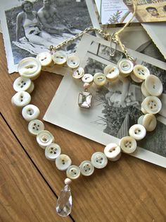 Shabby Chic Hanging HEART, Cottage Wall Decor, CREAM, Antique Mother of Pearl Buttons, Vintage charms. $65.00, via Etsy.