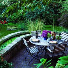 Alongside this Seattle patio, a  2 ½-ft.-wide planter was converted into a pond by sealing the interior with concrete.