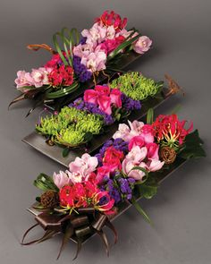 Devotion - A pavé of soft pink cymbidium orchids, purple statice, hot pink roses, glorosia lily, and green anastasia with lily grass and kiwi vine create a tapestry of colour and texture - Susan Penney