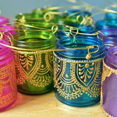 Set of Four Moroccan Lantern Votive Holders- In Fuschia, Purple, Turquoise, and Green Glass with Golden Details.