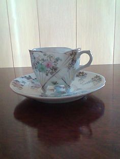 delicate cup and saucer +-90yrs old