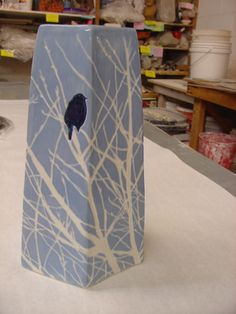 blue over porcelain (clear glaze) This looks a sneaky way to use colored porcelain in test extruder large square shape for glaze testing. White as slip newsprint transfer? Make soft slab with white tree stencil, or stamp, etc for best lines?