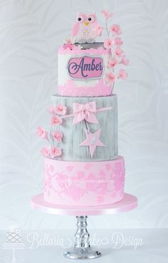 Adorable wood effect cake with a cute little owl on top! Pink and girlie! Lovely :) Cake by Bellaria Cakes Design by Riany Clement