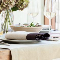 Natural linen napkin with fig purple aubergine border.  Cinta Fig Napkin by Huddleson Linens