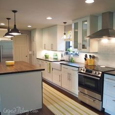 LOVE: subway tile, butcher block island, orb pendants, white cabinets, farmhouse sink, soapstone counters...
