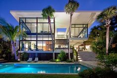 Facade of an Amazing Coral Gables House by Touzet Studio.  Read more about Coral Gables real estate at our blog http://coralgablesrealestatevault.com.  #moderncoralgables #coralgableshomes