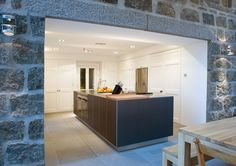 Prospect house extension and refurbishment - Bulthaup B3 island unit - granite floor slabs - oak table frameless glazing - modular lighting instruments - LED lights Stainless Steel - designed by www.jamstudio.uk.com