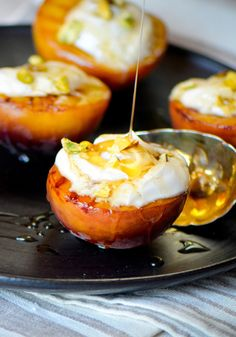 Now-ubiquitous Greek yogurt is a perfect healthy substitute for cream. And mixing it with honey is right up there in the pantheon of great pairings, alongside peanut butter and jelly. For this dish, slide peaches under the broiler, which helps bring out their natural sweetness, and serve them warm, covered in thick yogurt and floral-tasting honey. A smattering of crushed pistachios on top is the ideal finish.