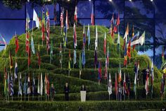 This is THE coolest picture! This is Glastonbury Tor at the opening ceremony with the flags of all the nations pinned to it...