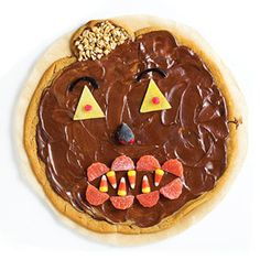Jack-o-Lantern Peanut Butter Cookie Dessert Pizza. Recipe: http://www.midwestliving.com/recipe/cookies/peanut-butter-cookie-pizza