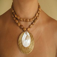 Smooth wooden beads with an ethnic pendant