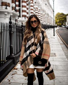 Burberry Poncho (sold out, similar here) ASTR Turtleneck Sweater (wearing an XS) Michelle Mason White Leather Skirt (on sale now – wearing a Gucci Velvet Bag Stuart Weitzman Over-The-Knee Boots (run TTS) Givenchy Sunglasses Chic Winter Outfits, Winter Skirt Outfit, Classy Outfits, Burberry Poncho, Burberry Outfit, White Leather Skirt, Poncho Outfit, Dress Ootd, London Outfit