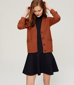 I like the color of the cardigan with the black.  The fit is a bit boxy for me, though.