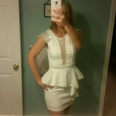White Peplum Windsor Dress Peplum Style with beautiful rhinestone details on the shoulders.  See thru mesh in the front. Perfect condition. Never worn. Don't really want to sell but need to! WINDSOR Dresses