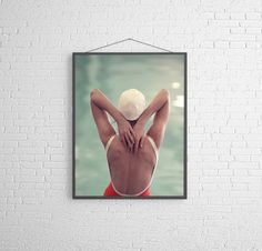 New 2014 from my on going series of a female swimmer in a vintage bathing suit and cap, swimming in a mid century pool. (the second image