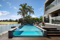 Exterior // The Signature by Metricon Riviera, on display in Sorrento, QLD. Pergola Attached To House, Dream Pools, Real Estate Leads, Facade House, House Facades, Display Homes, Building A New Home, Pool Houses, Indoor Outdoor