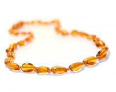 click image to enlarge Baltic Amber Teething Necklace, Baby Gallery, Amber Resin, Baby Teethers, Baby Keepsake, Baby Gifts, Beaded Bracelets, Honey, Cure